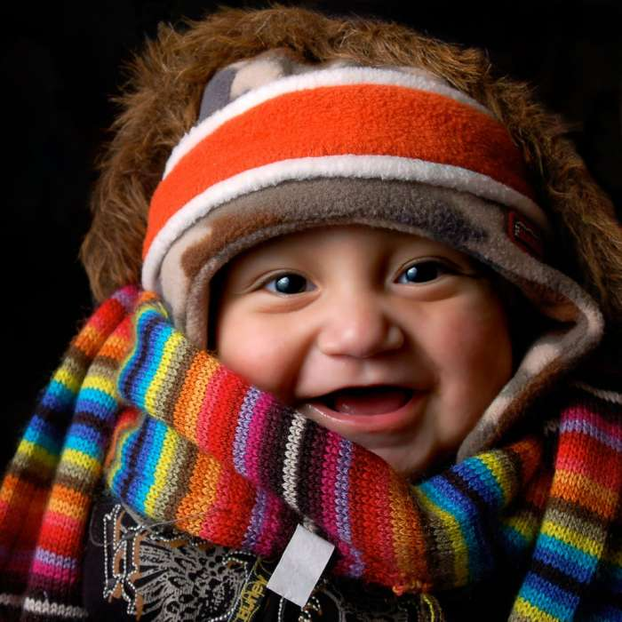 Photo of a baby wearing many items of winter clothing, 2007